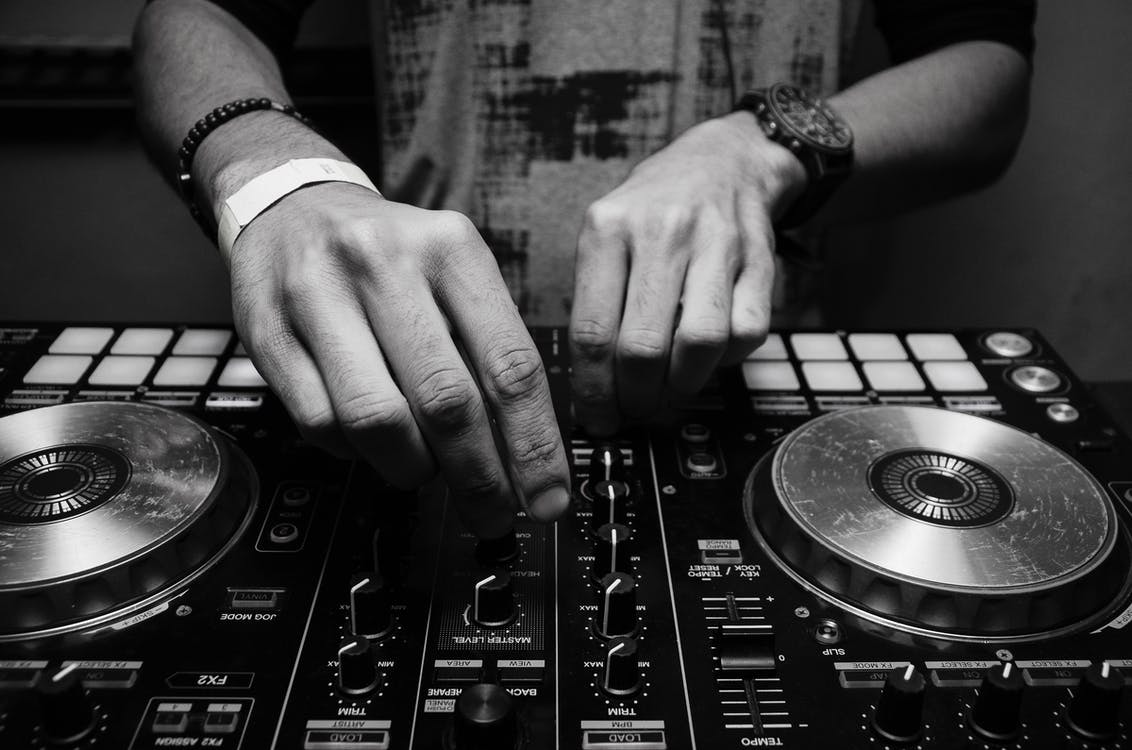 Grayscale Photography of Person Using Dj Controller