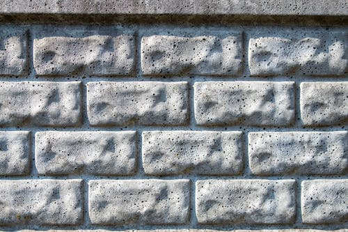 Close-Up Shot of Gray Brick Wall