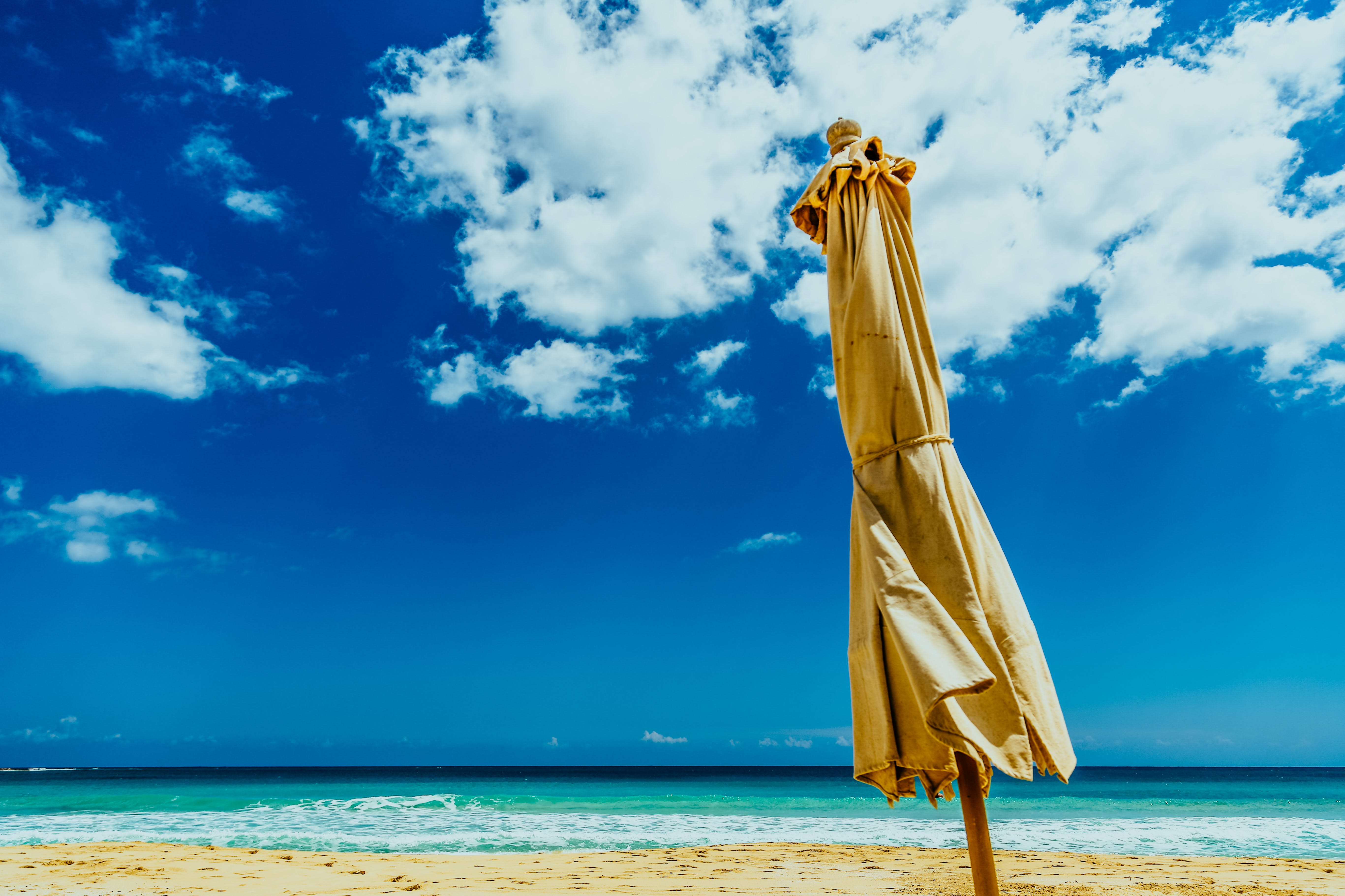 Brown Umbrella on Seashore