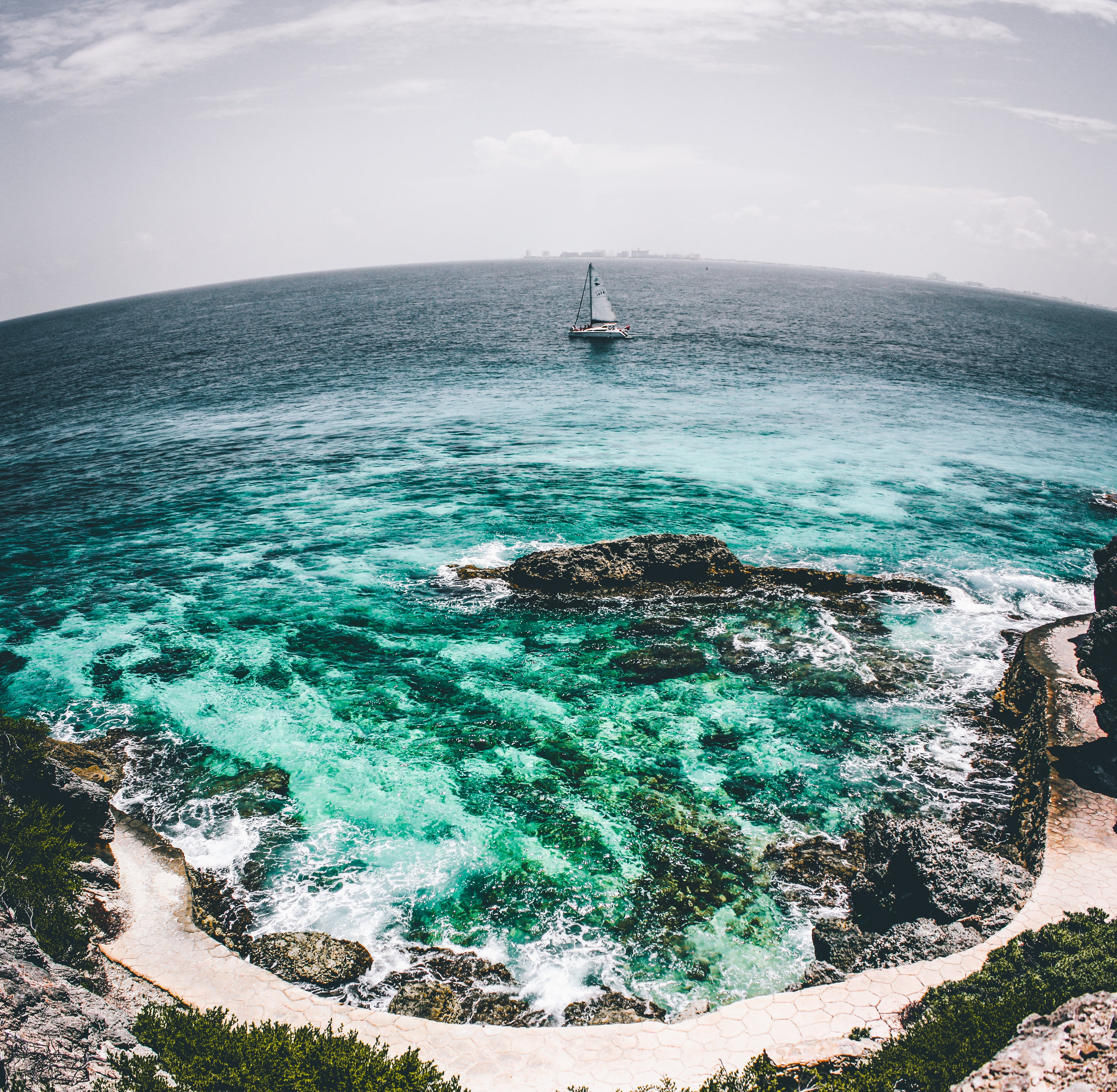White Sailboat on Sea Water Fish-eye Photo
