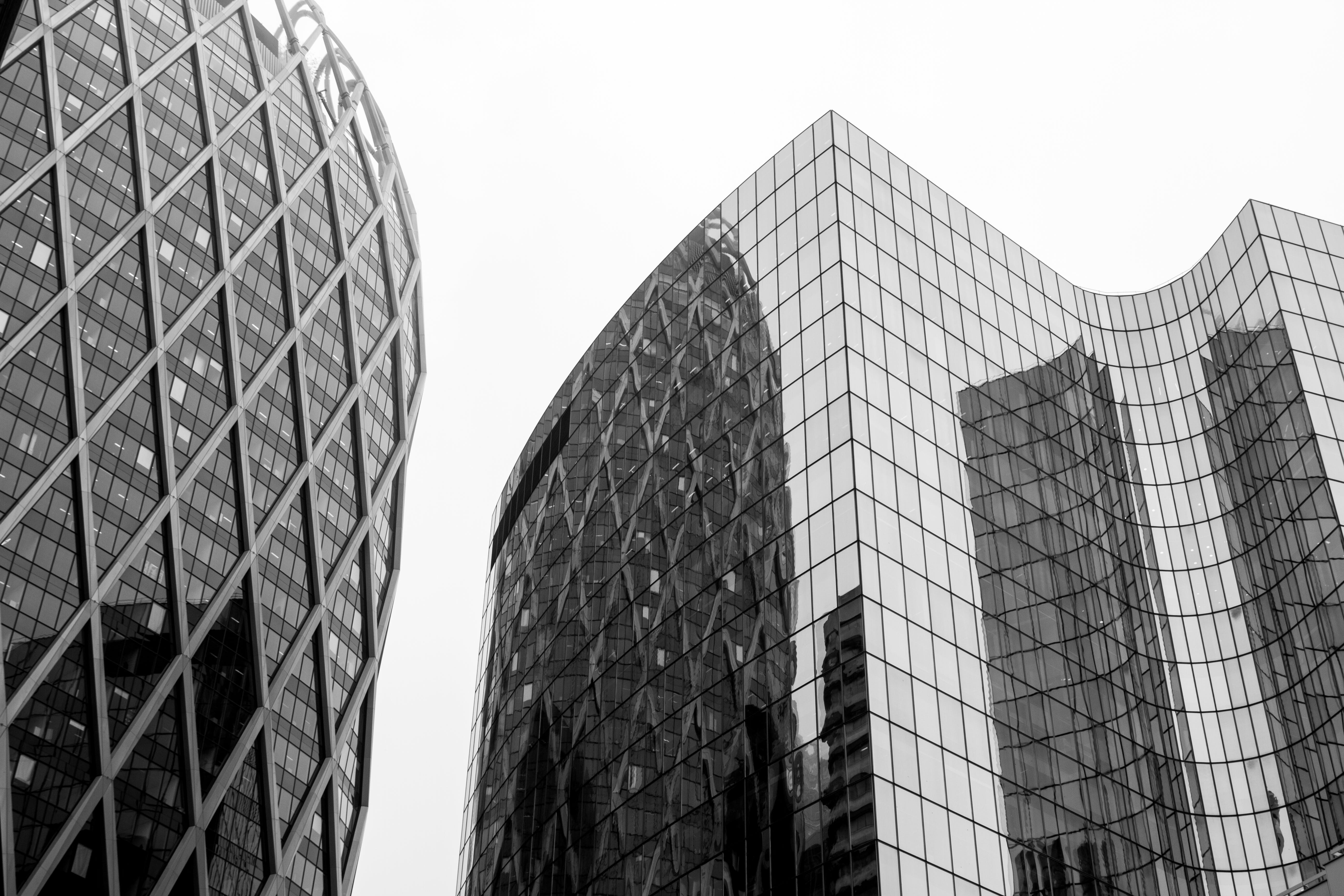 Greyscale Photo Of Glass Window Buildings