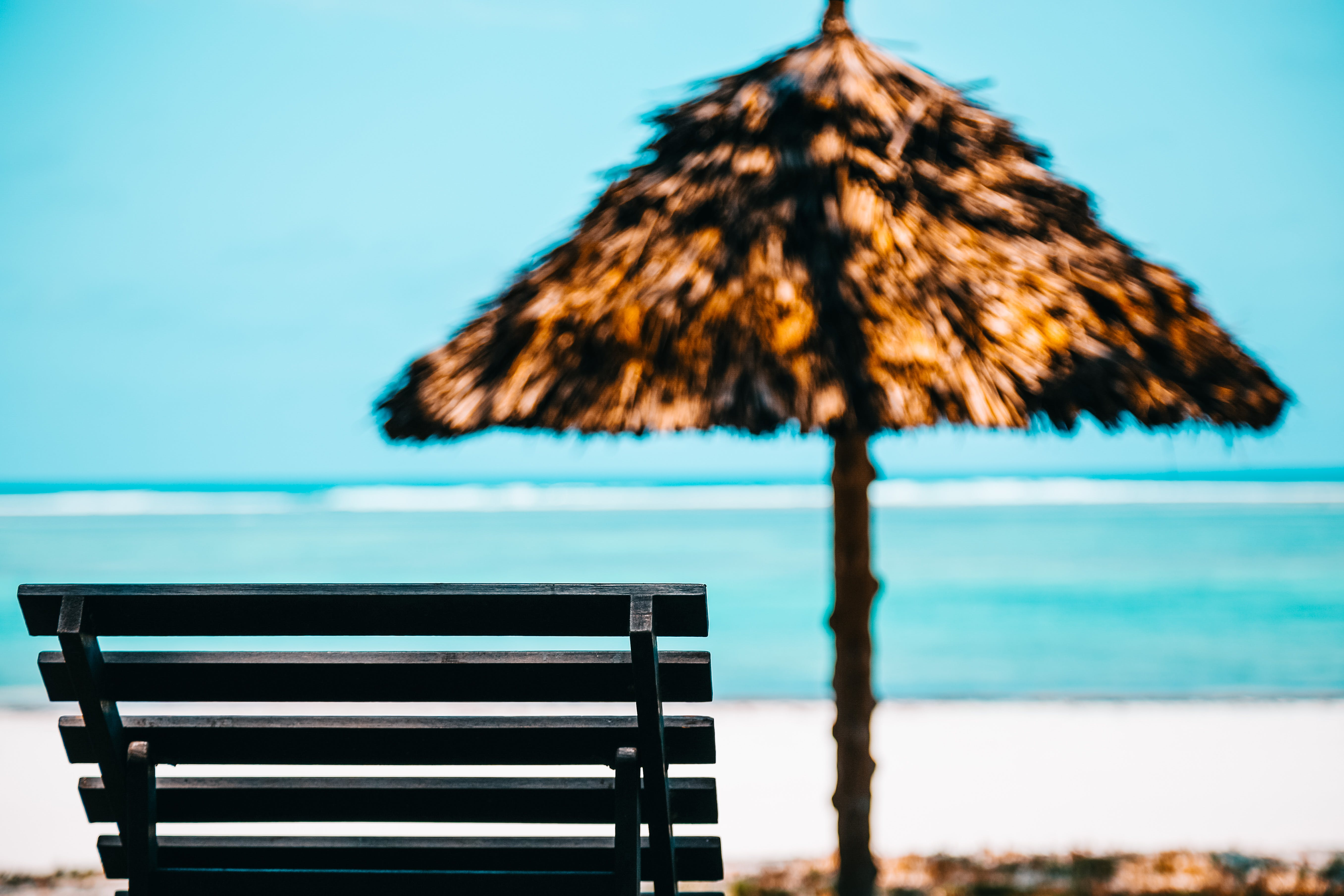 Beach Lounge Chair With Straw Parasol
