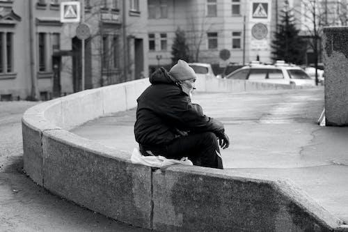 Elderly Man in Jacket Sitting Alone