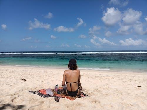 Woman in Black Bikini Sitting on Beach