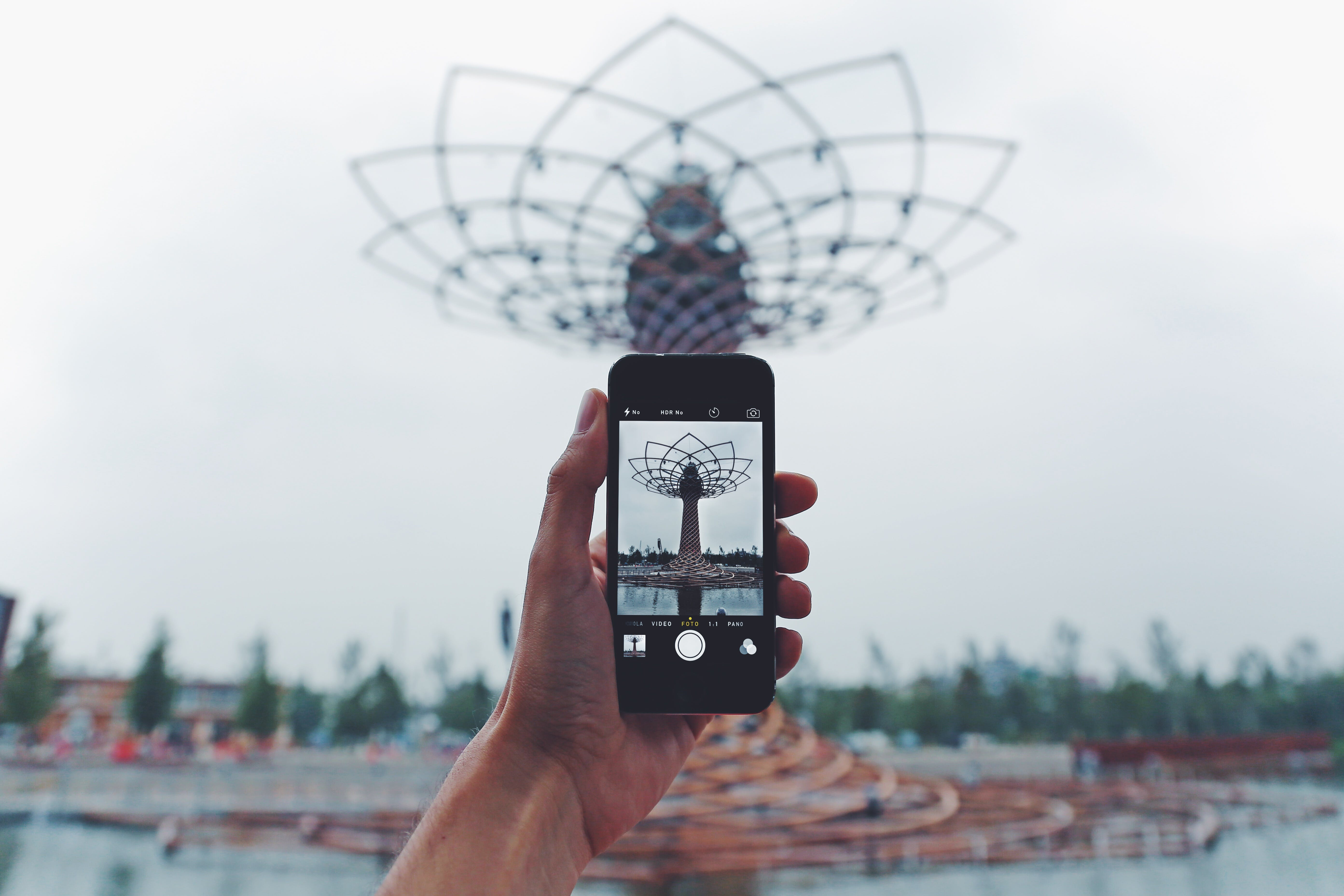 Person Taking Photo of Tower