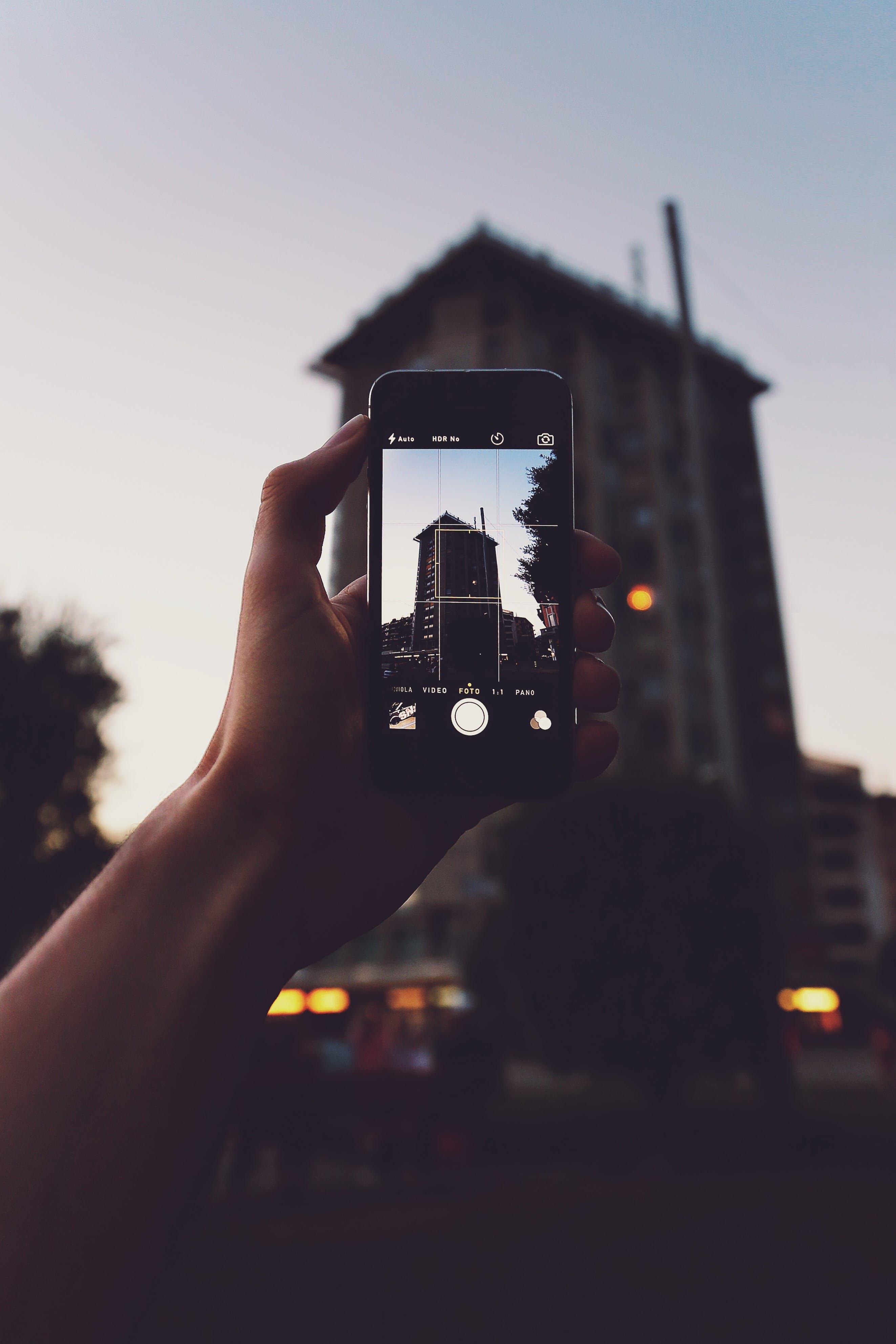 Kostenloses Stock Foto zu sonnenuntergang, person, hand, beleuchtung