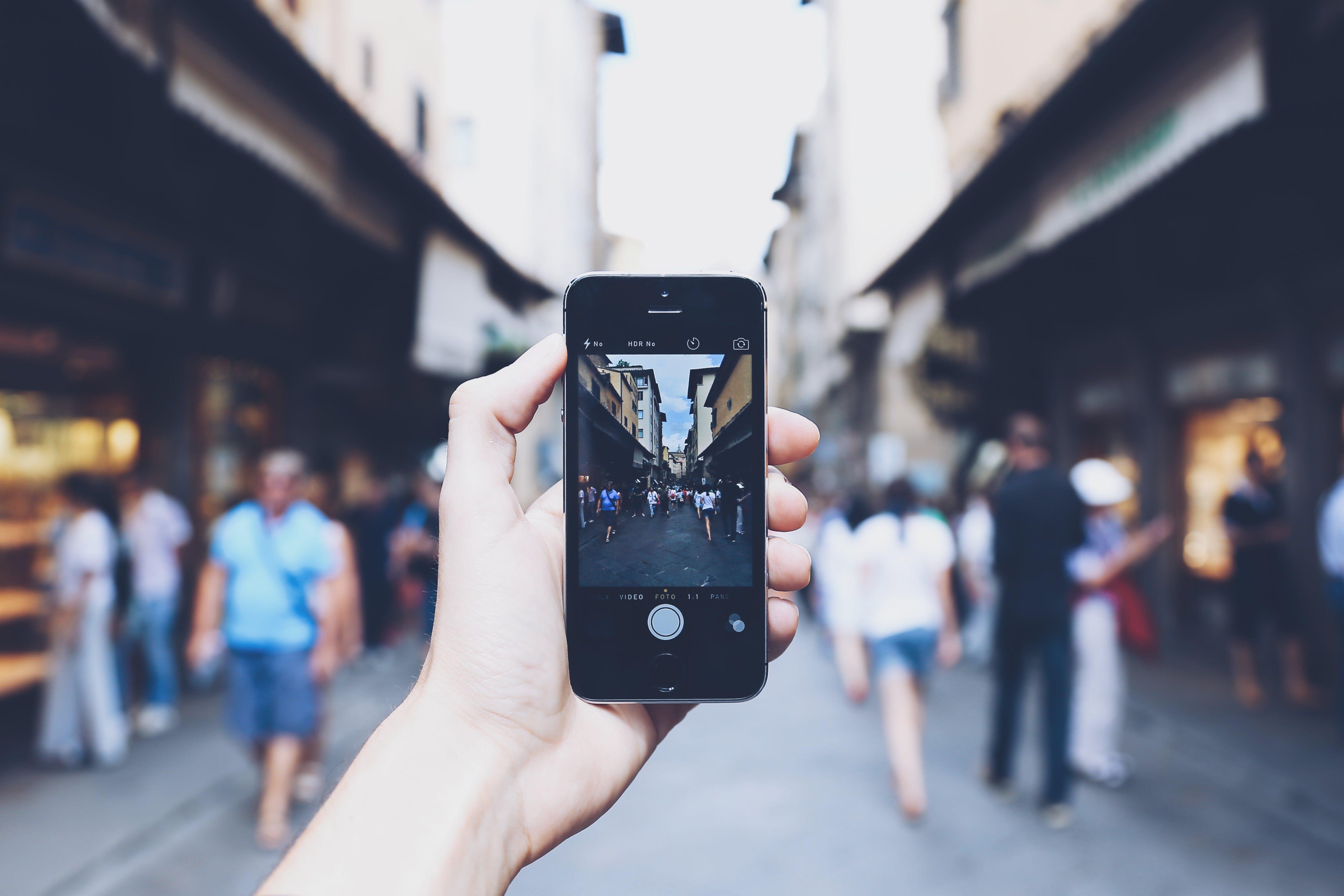 Free stock photo of men, technology, holding, device