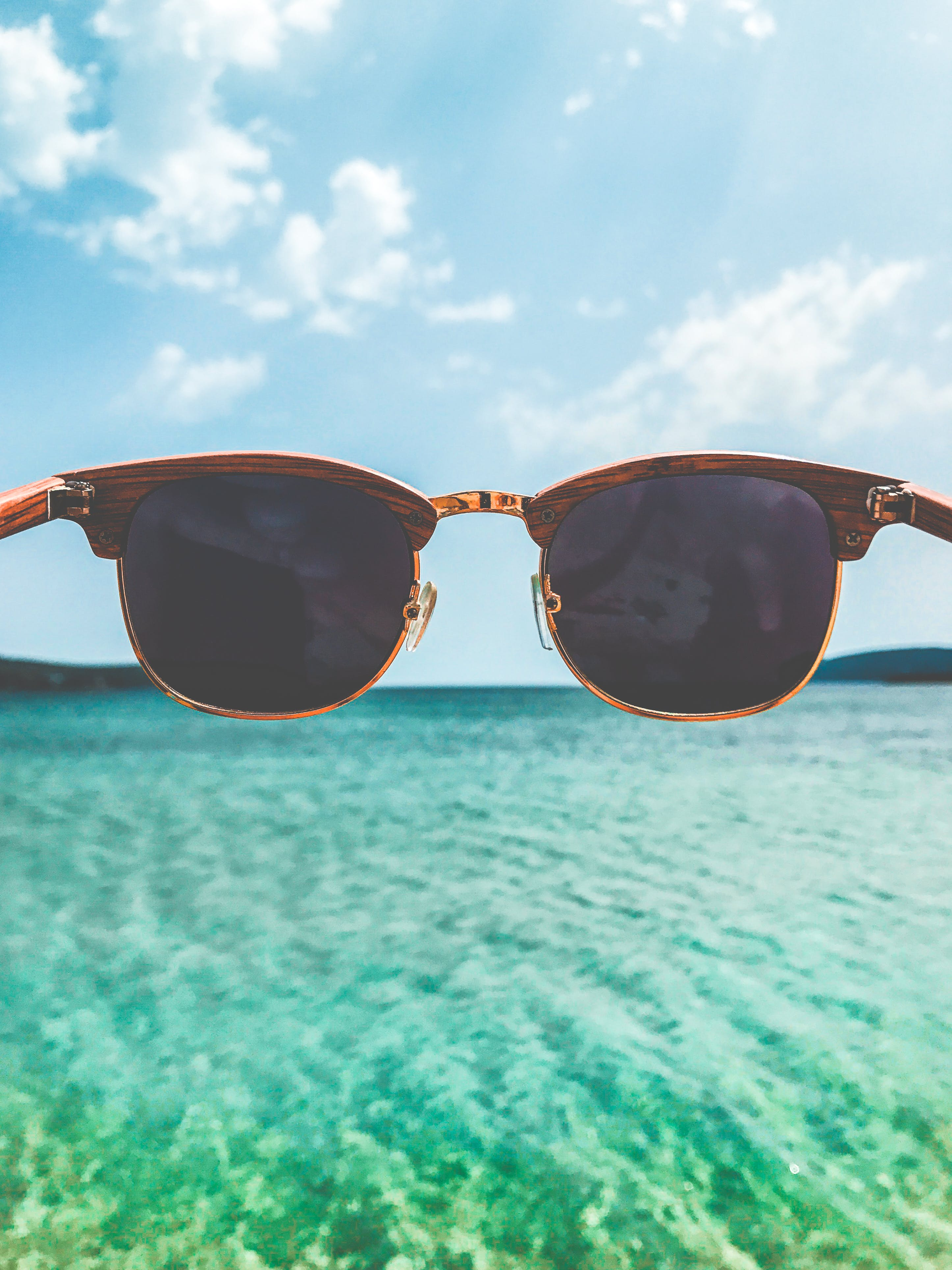Close Up Photography of Brown Clubmaster Style Sunglasses