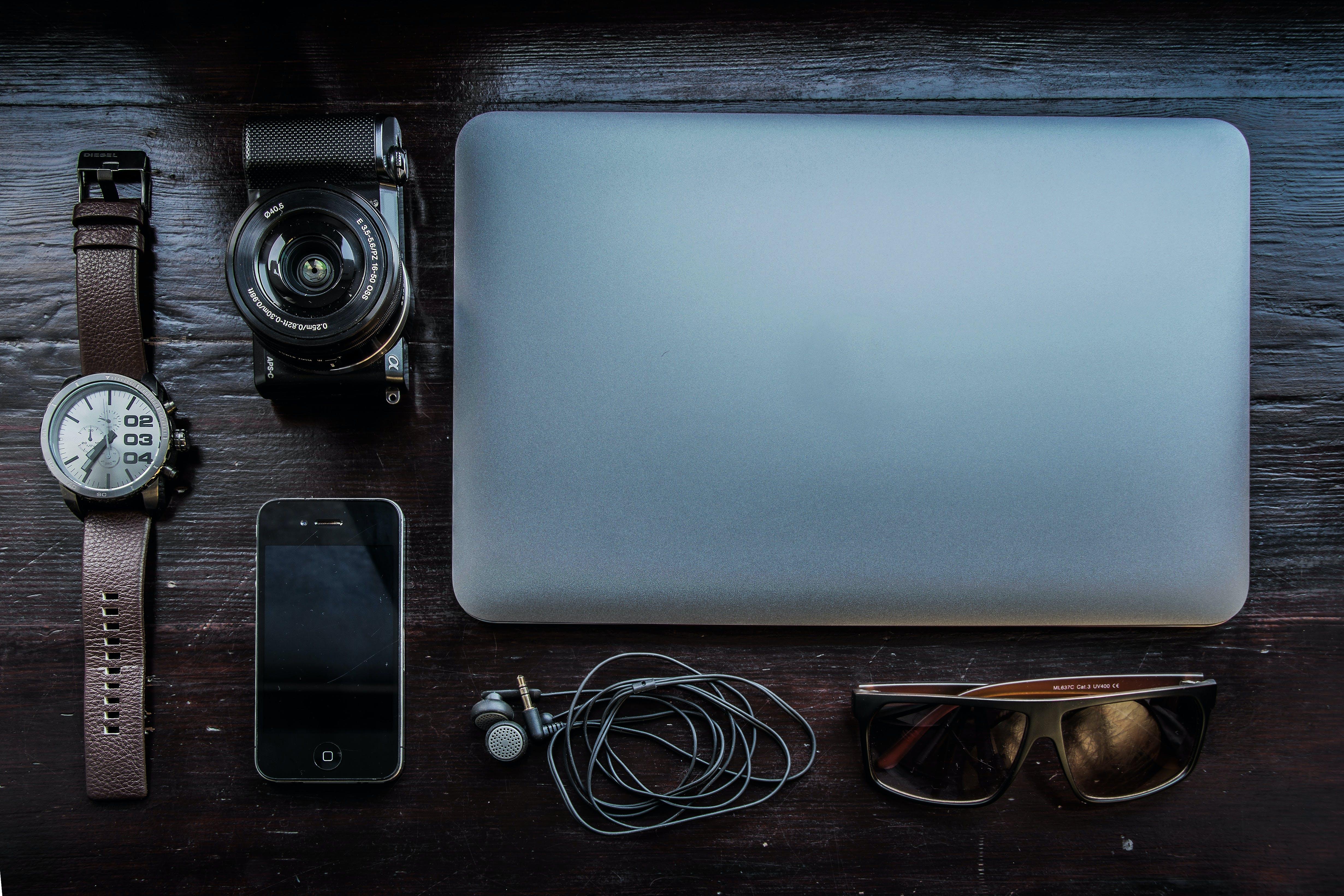 Silver Laptop Computer and Black Bridge Camera