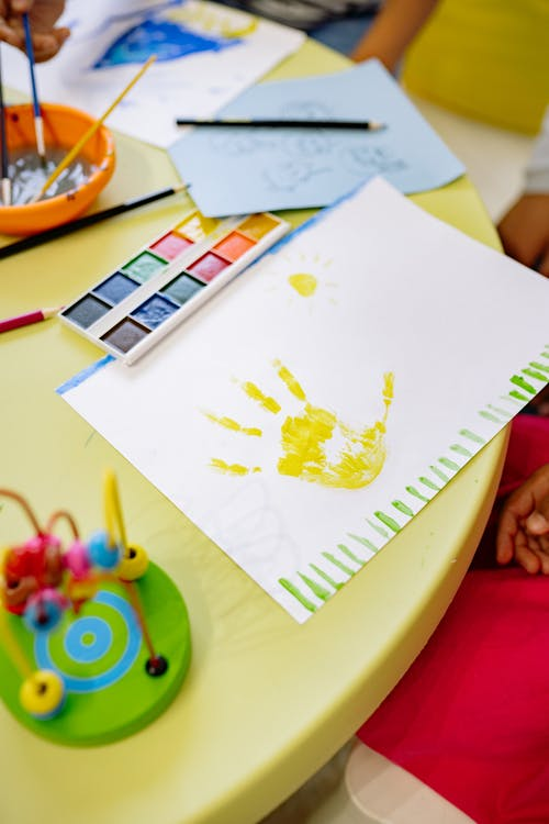 Art Materials And Painting Of a Hand On Table