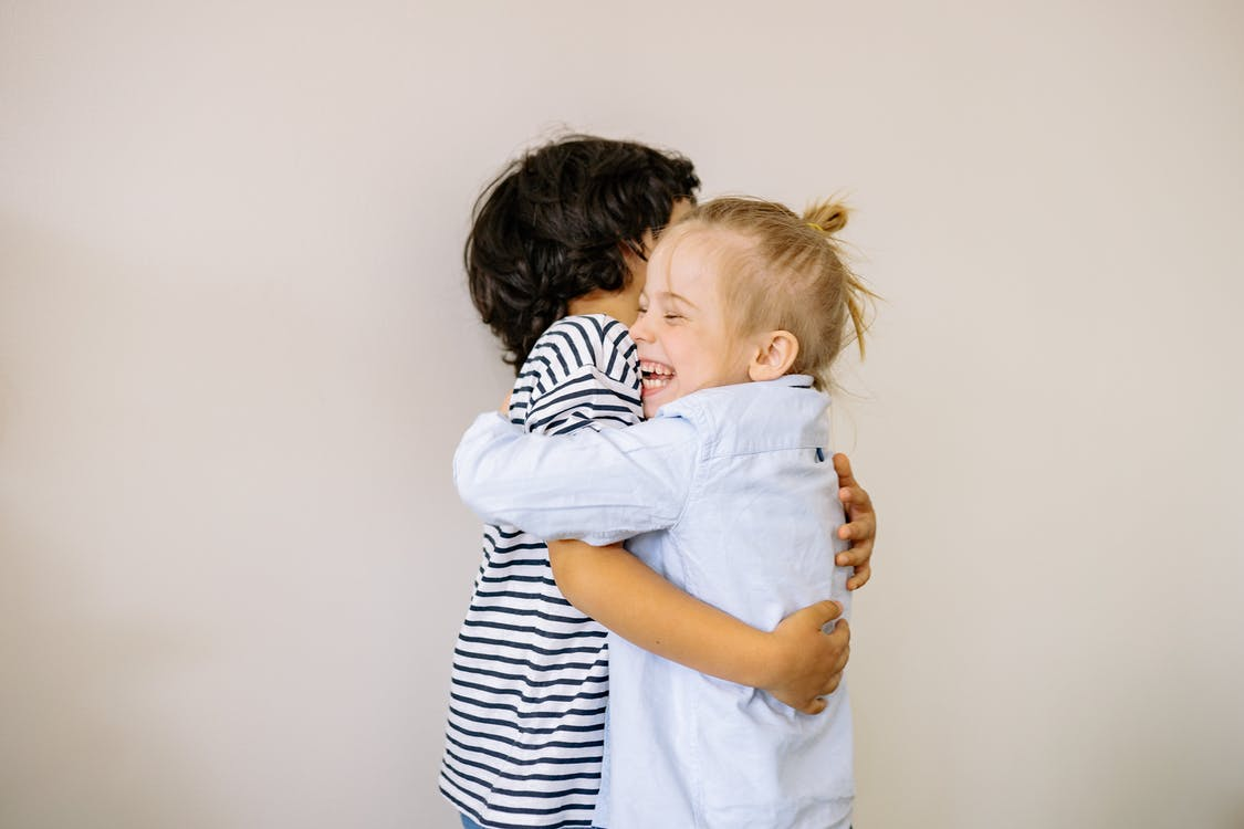 A Boy and Blonde Girl Hugging Each Other