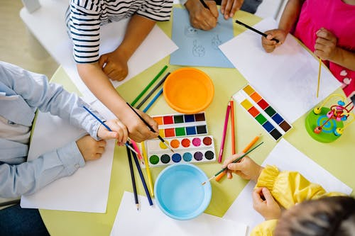 Group of Children Doing Painting With Water Color