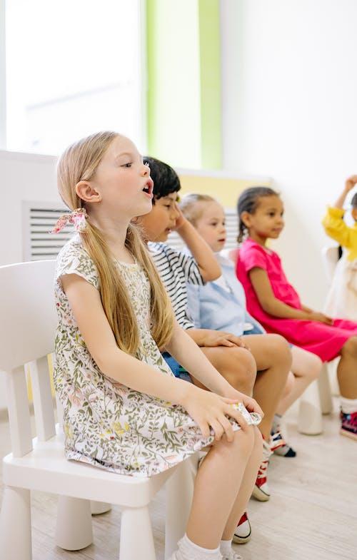 Children Sitting Inside a Classroom