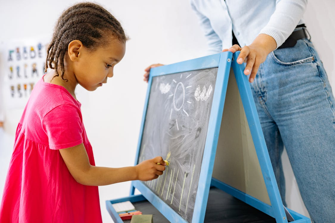 Boy in White Dress Shirt Holding Blue and White Wooden Frame