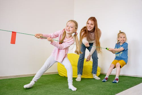 Two Girls and A Woman Pulling A Rope Together