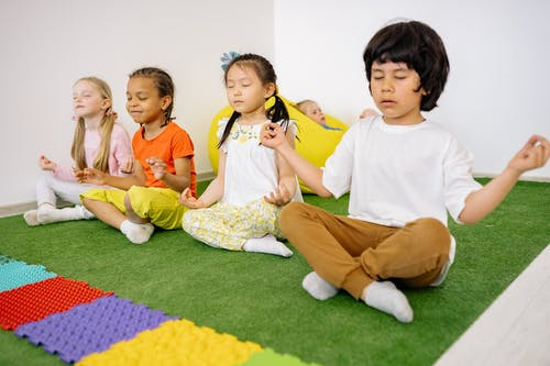 Children In Criss Cross Position With Closed Eyes
