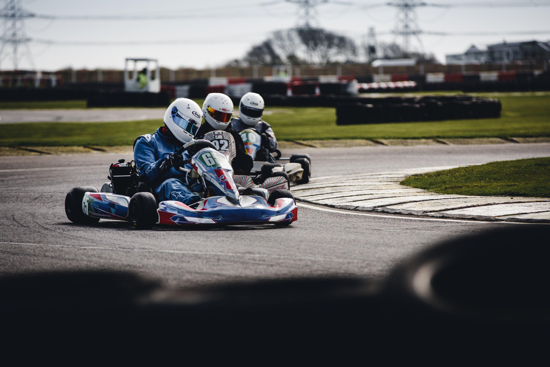 Three Men Riding on Go Karts