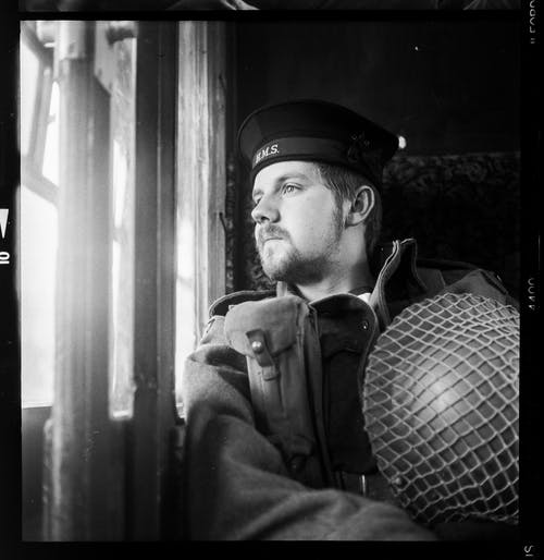 Grayscale Photo Of Man Wearing A Hat