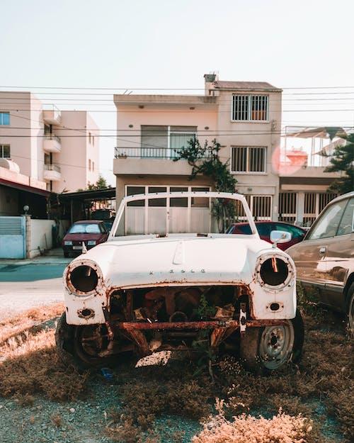 A Broken Car Parked Outdoors