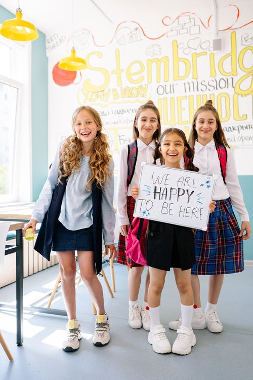 School Girls Smiling while Standing