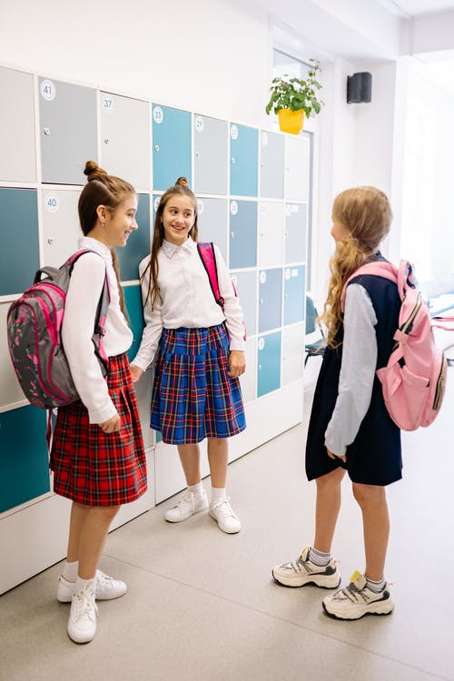 Girls Hanging Out by the Lockers