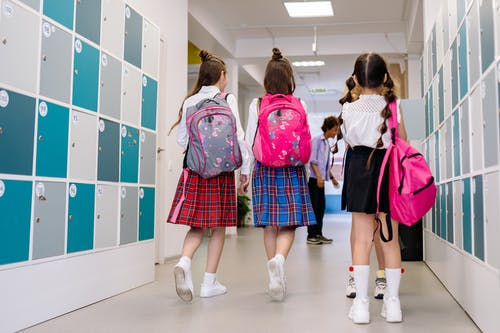 Back View of Students Walking on the Corridor