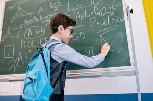 Smart Boy Solving a Math Problem