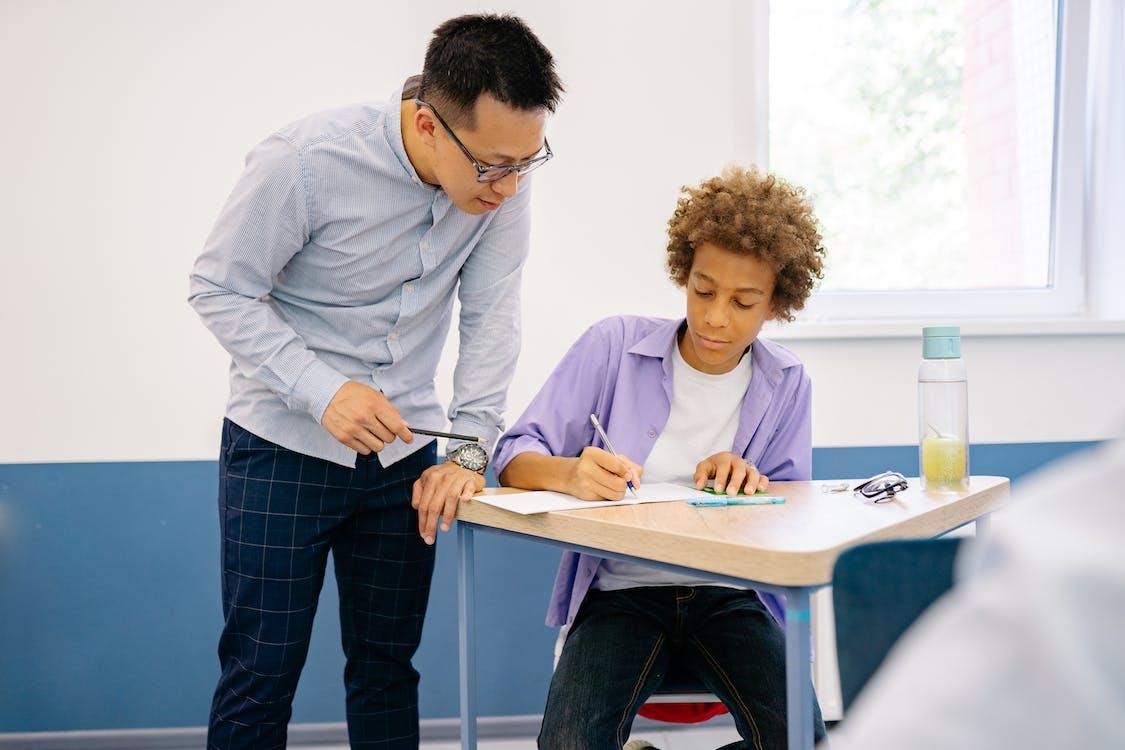 Teacher Teaching His Student