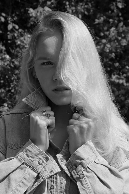 Grayscale Photo of a Pretty Woman in a Denim Long Sleeves