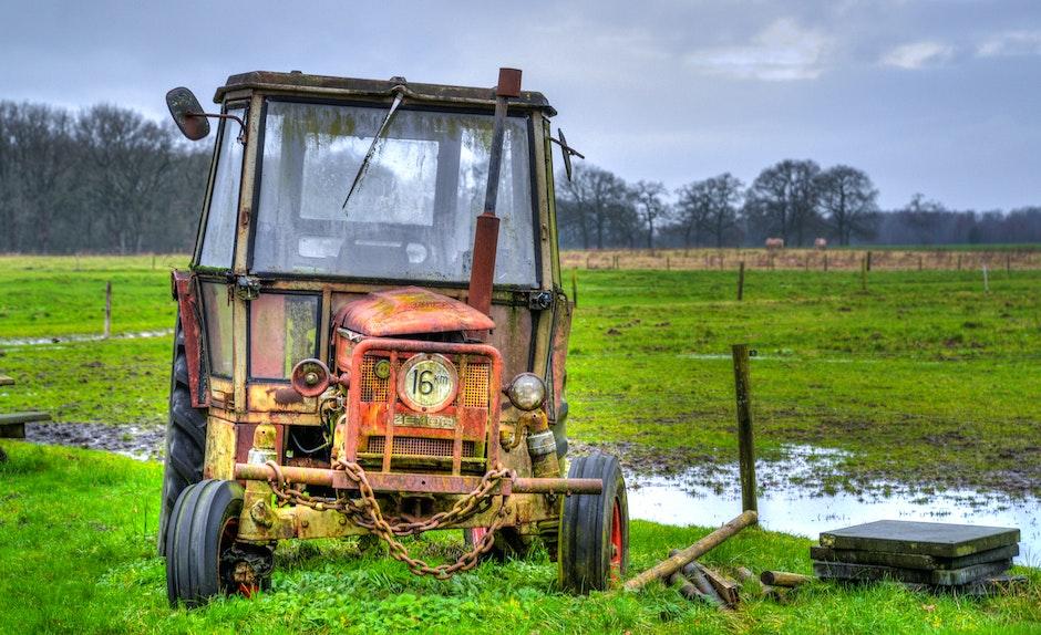 Yellow Farm Equipment on Green Grass Field