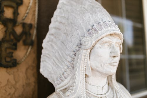 Close-Up Photo of a White Statue