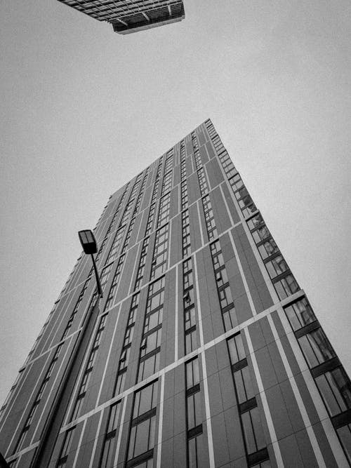 Grayscale Photo of a High-Rise Building