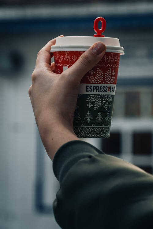 Close-Up Shot of a Person Holding a Cup of Drink