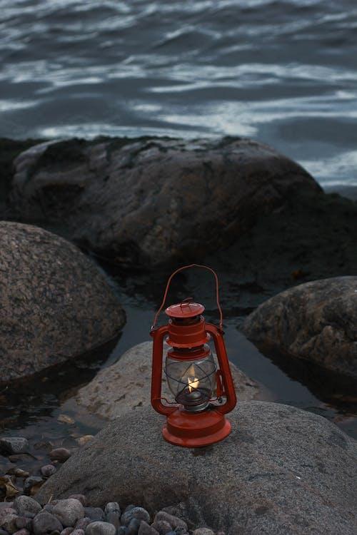Red Oil Lamp on Boulder