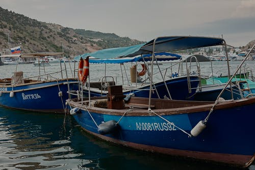 Brown and Blue Boats Docked on Harbor