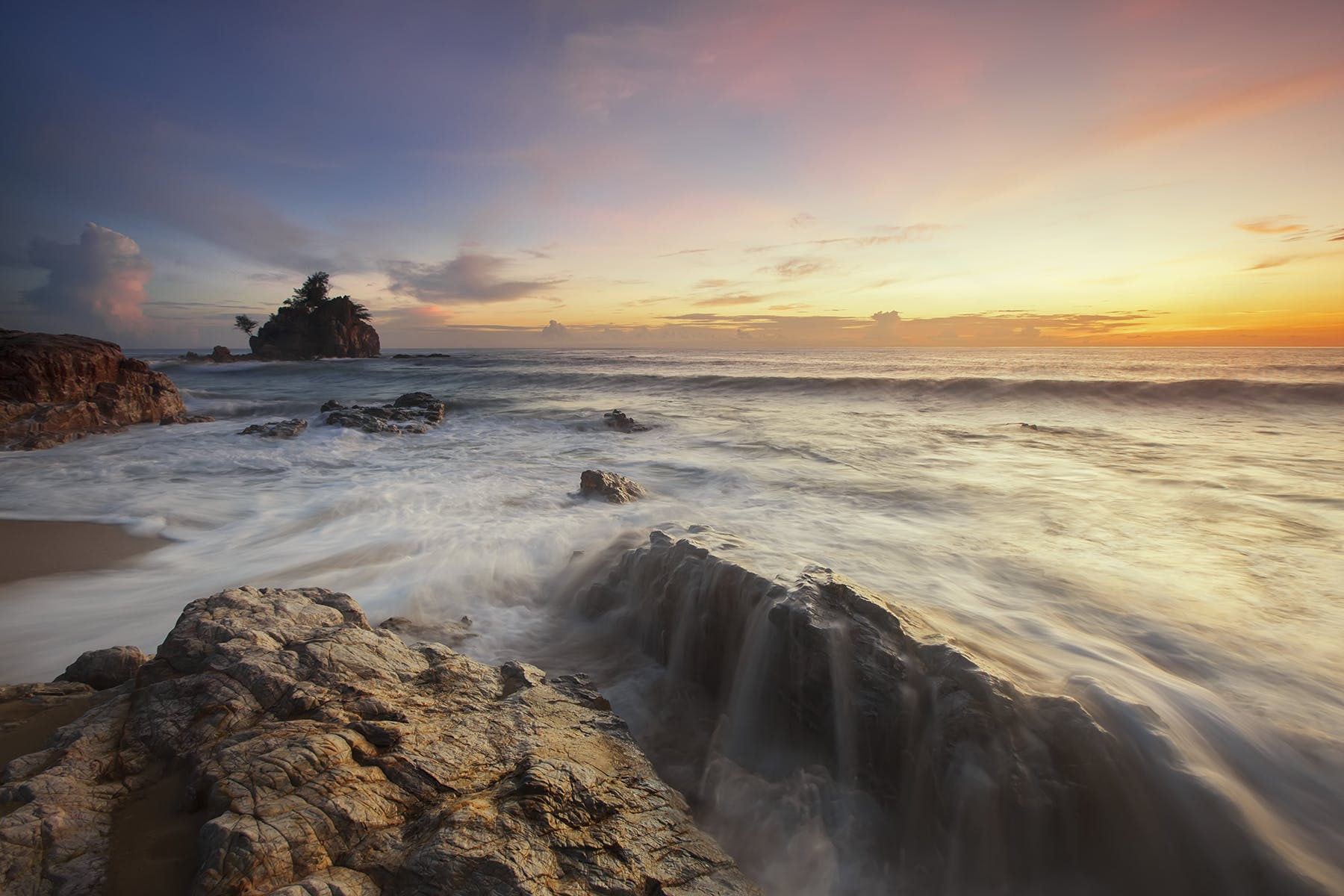 Brown and Grey Rock Near Sea during Sunrise