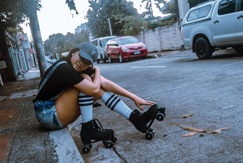A Roller Skater Sitting on the Curb