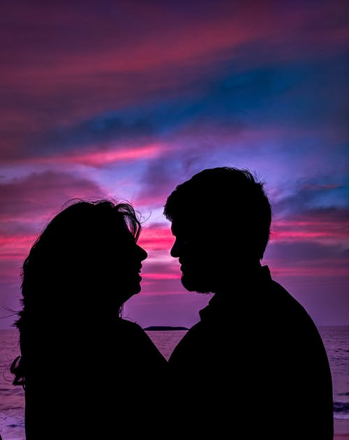Silhouette of Couple Facing Each Other