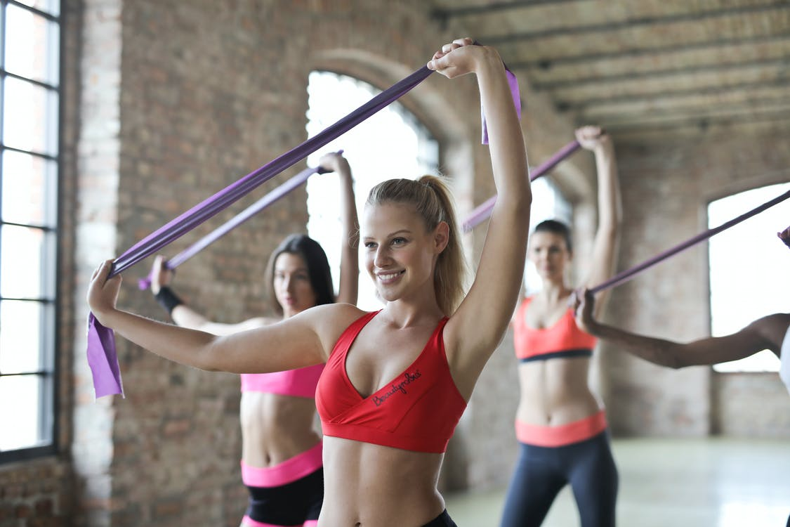 Three Women's Doing Exercises