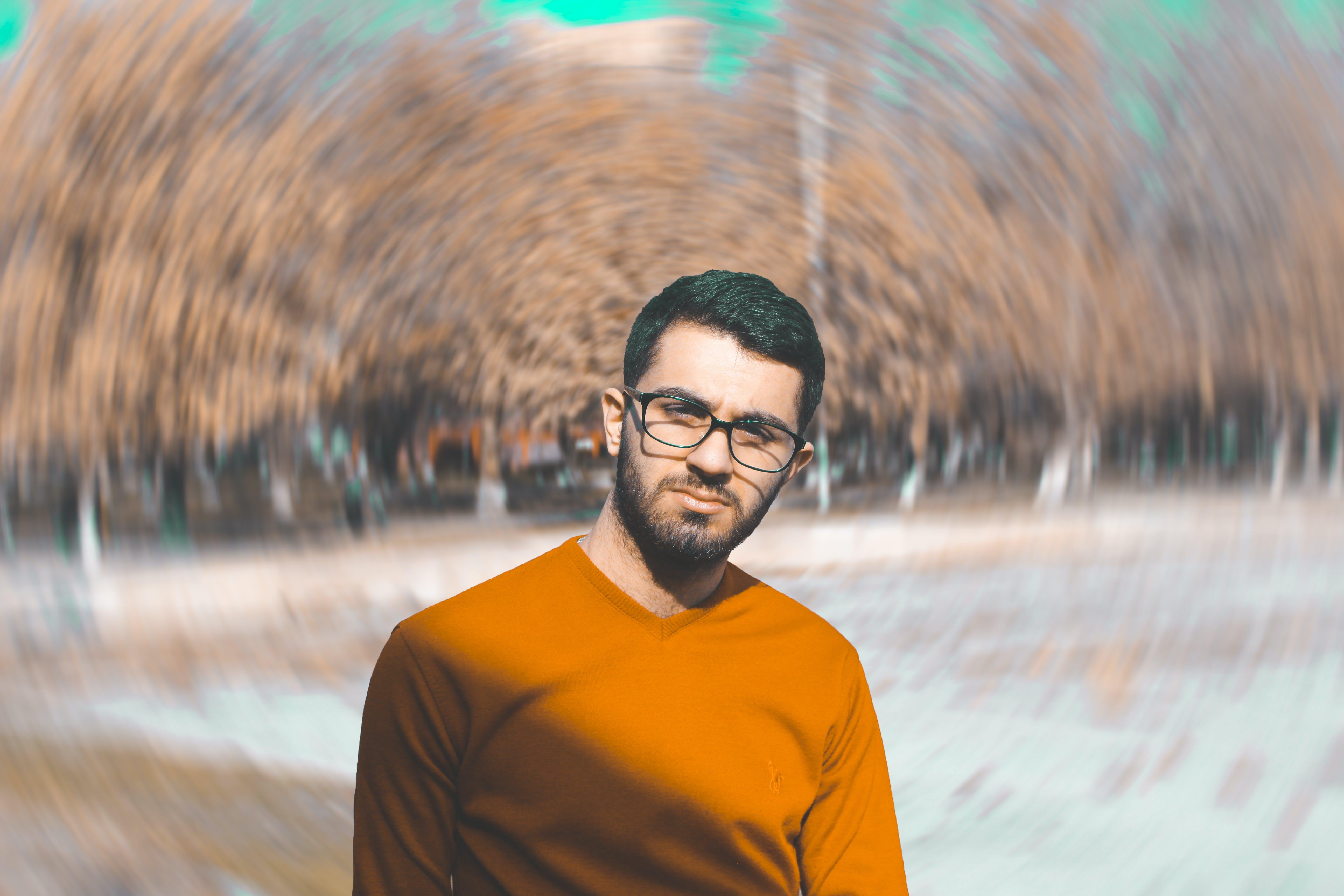 Man in Orange Crew-neck Top