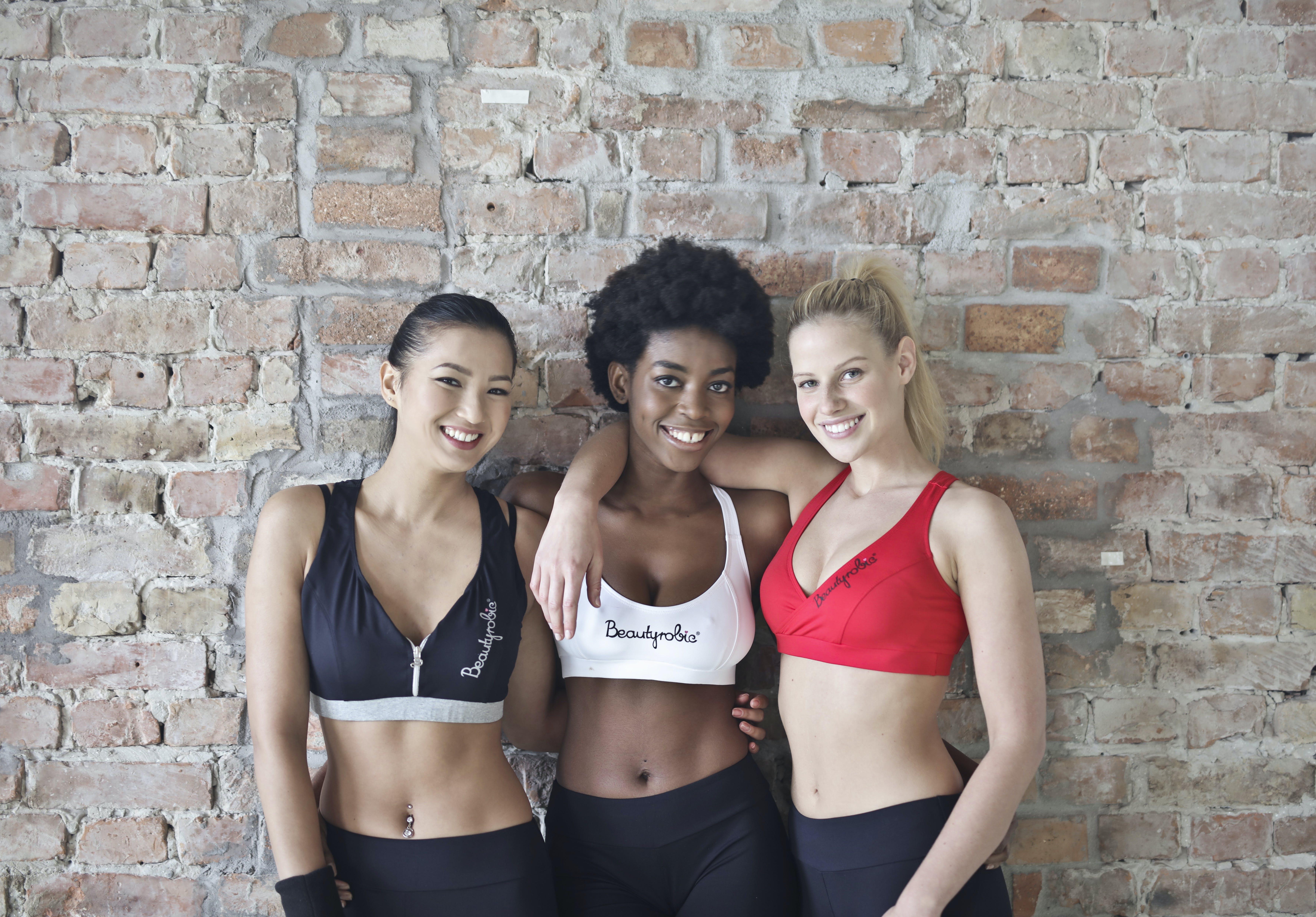 Three Women Wearing Sports Bras and Leggings