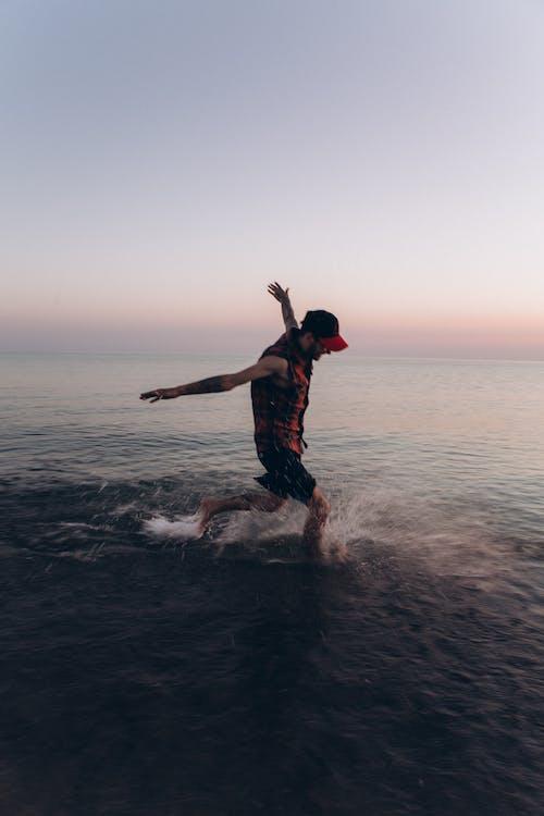 Man Standing on Sea Water