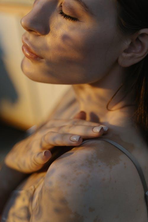 Close Up Photo of Woman's Shoulder