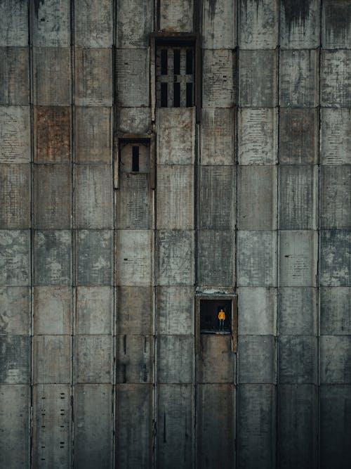 Black and Brown Door on Brown Brick Wall