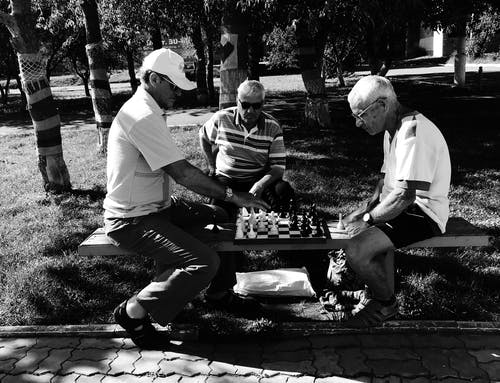 Grayscale Photo of Men Playing Chess