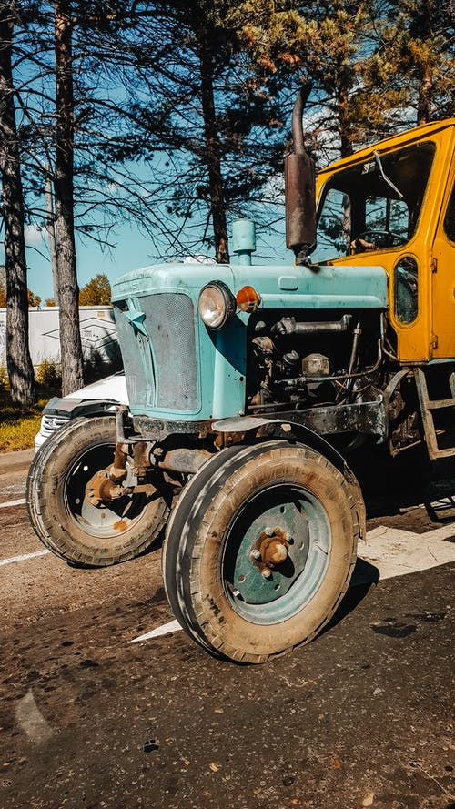 Green and Yellow Tractor on Road