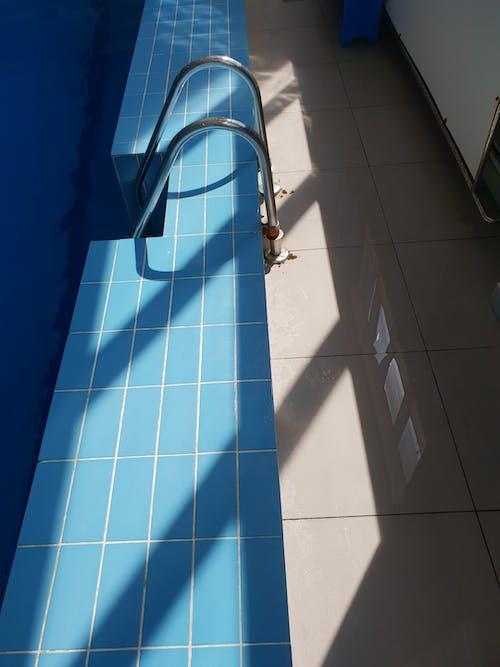 White Metal Pipe on White Tiled Wall