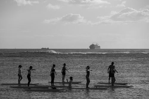 Silhouette of People Walking on Beach