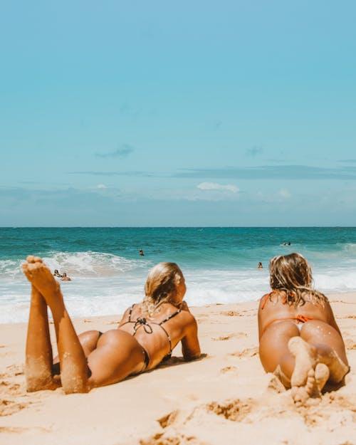 2 Women Lying on Beach