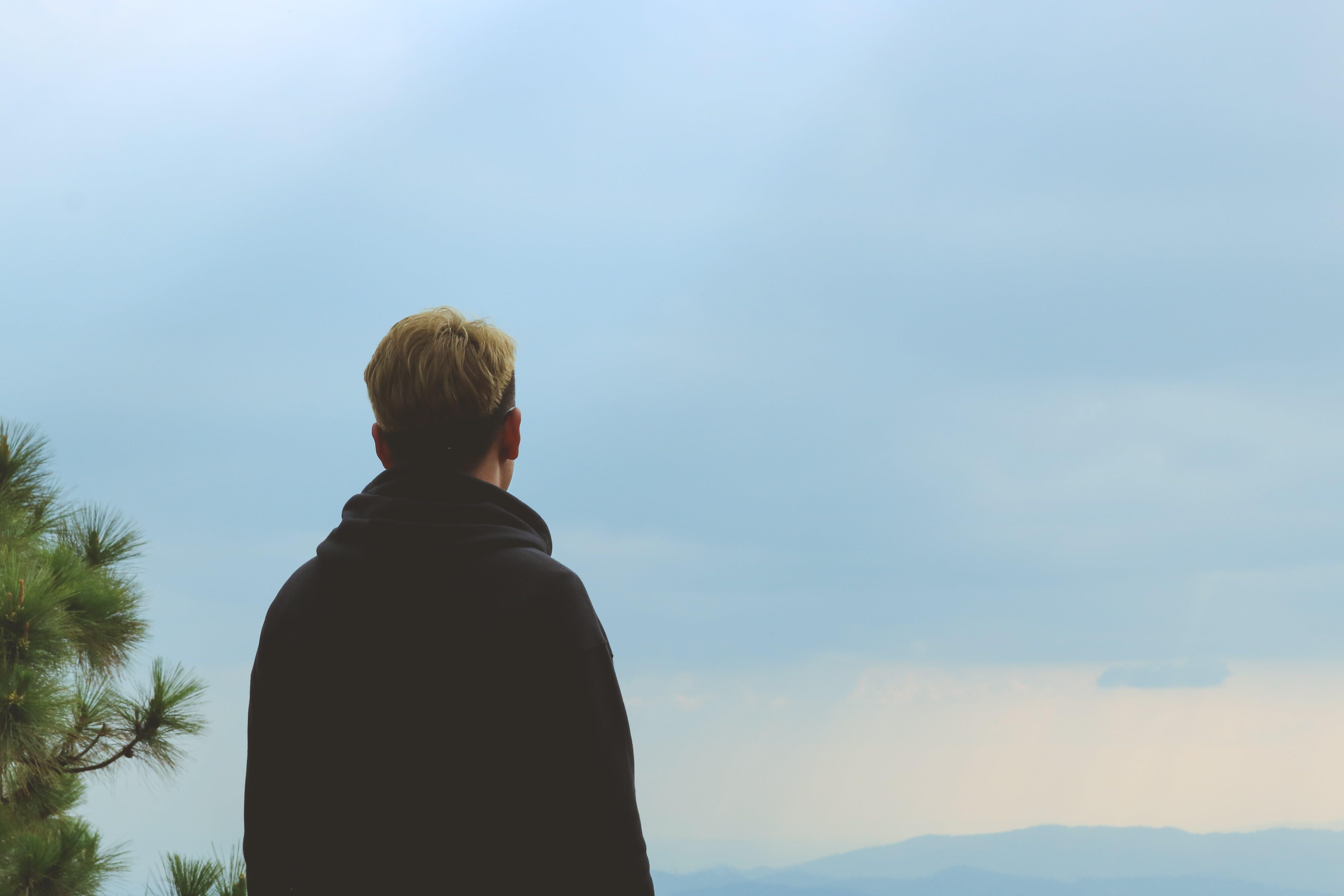 Man Wearing Black Jacket Standing Near Tree